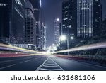 the traffic light trails of city | Shutterstock . vector #631681106