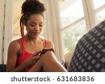 black girl lying on couch and... | Shutterstock . vector #631683836