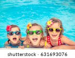 happy children in the swimming... | Shutterstock . vector #631693076