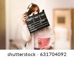 young woman in dressing gown... | Shutterstock . vector #631704092