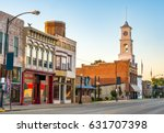 Main street of a quaint, classic small town in midwest America with storefronts and a clock tower