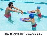 coach assisting a kids in...   Shutterstock . vector #631713116