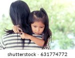 mother and child cute little... | Shutterstock . vector #631774772
