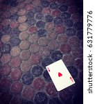 Small photo of Ace of hearts card on the dirty floor. Good luck concept.
