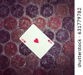 Small photo of Ace of hearts card on the floor. Good luck concept.