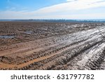 vanishing dirt road through... | Shutterstock . vector #631797782