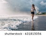 active sporty woman run along... | Shutterstock . vector #631815056