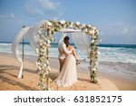 bride and groom enjoying beach... | Shutterstock . vector #631852175