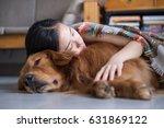 girl holding the golden... | Shutterstock . vector #631869122