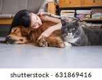 girls sleep with cats and dogs | Shutterstock . vector #631869416