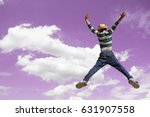 happy boy in motion jumping... | Shutterstock . vector #631907558