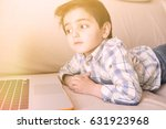 little boy lying on the couch... | Shutterstock . vector #631923968