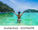 happy woman in bikini playing... | Shutterstock . vector #631946498