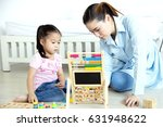 asian mother and daughter...   Shutterstock . vector #631948622