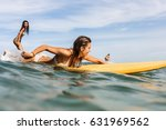 two beautiful fit surfing girl... | Shutterstock . vector #631969562