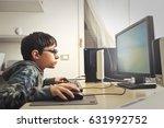 nerd child playing computer... | Shutterstock . vector #631992752
