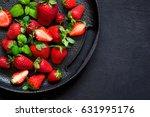 juicy ripe strawberries on a... | Shutterstock . vector #631995176