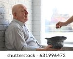 senior man with hat asking for... | Shutterstock . vector #631996472