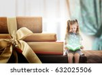Small photo of Adventure story and fairy tale. Tiny girl with books and magic glowing on table
