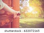 women hand open door knob or... | Shutterstock . vector #632072165