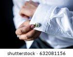 A Man Adjusts His Cuff On A...