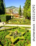 Small photo of Alhambra garden summer landscape. Summer park in mountains. Alhambra, Granada, Spain