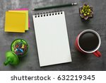 notebook on office table with a ...   Shutterstock . vector #632219345