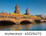 Classic panoramic view of famous Oberbaum Bridge with historic Berliner U-Bahn crossing the Spree river on a beautiful sunny day with blue sky in summer, central Berlin, Germany