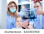 Dentists looking at patient's x-ray image in dental office.  - stock photo