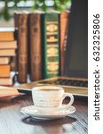 hot cup of coffee and reading a ... | Shutterstock . vector #632325806