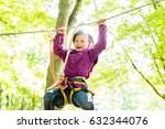 girl climbing in high rope... | Shutterstock . vector #632344076