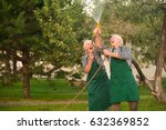 cheerful people and water hose. ... | Shutterstock . vector #632369852