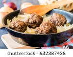 Small photo of Meatballs on frying pan stuffed with onion