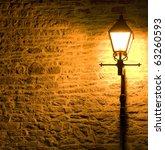 Lit Lamp Post Against A...