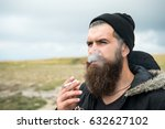 bearded man smoke cigarette ... | Shutterstock . vector #632627102