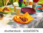 table served with disposable... | Shutterstock . vector #632653076