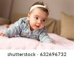 beautiful baby girl crawling... | Shutterstock . vector #632696732