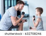 boy training with dumbbells... | Shutterstock . vector #632708246