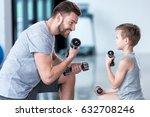 boy training with dumbbells... | Shutterstock . vector #632708246