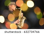 Man Playing On Saxophones.