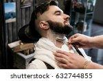 hairdresser man shaves a client ... | Shutterstock . vector #632744855