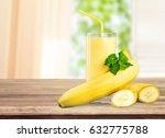 Banana And Juice On Table.