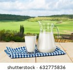 a glass of milk and a milk jug... | Shutterstock . vector #632775836
