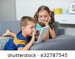 siblings using digital tablet... | Shutterstock . vector #632787545