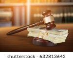 Small photo of Money and gavel on table.
