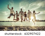 friends jumping on the beach... | Shutterstock . vector #632907422