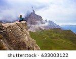 girl hiker sitting at the edge... | Shutterstock . vector #633003122
