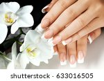 female hands with white nails... | Shutterstock . vector #633016505