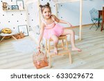 little girl is hugging a cage... | Shutterstock . vector #633029672