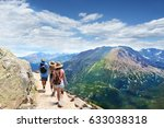 people with backpacks hiking on ... | Shutterstock . vector #633038318